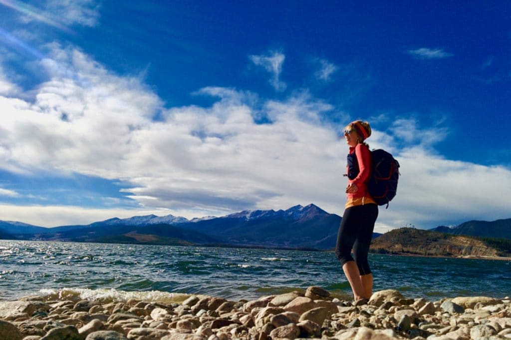 Heidi standing on the shore of Lake Dillon